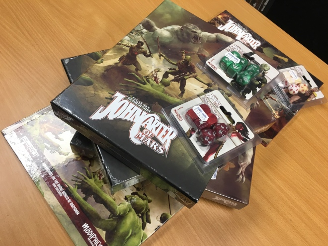 A stack of products for Modiphius' John Carter of Mars